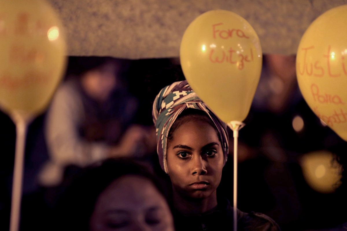 A woman holds a yellow balloon in memory of 8-year-old Agatha Sales Felix during a protest against the security policy of the state, in Rio de Janeiro, Brazil. Agatha was killed by a stray bullet in a Rio de Janeiro shantytown amid allegations that she was hit by police fire, shot in the back while riding in a van in the Complexo do Alemao slum. (AP Photo/Silvia Izquierdo)