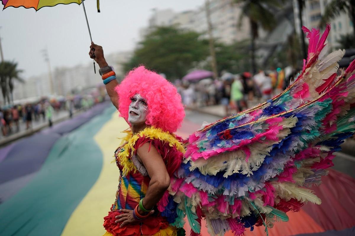 A person in costume strikes a pose during the annual gay pride parade along Copacabana beach in Rio de Janeiro, Brazil. (AP Photo/Leo Correa)