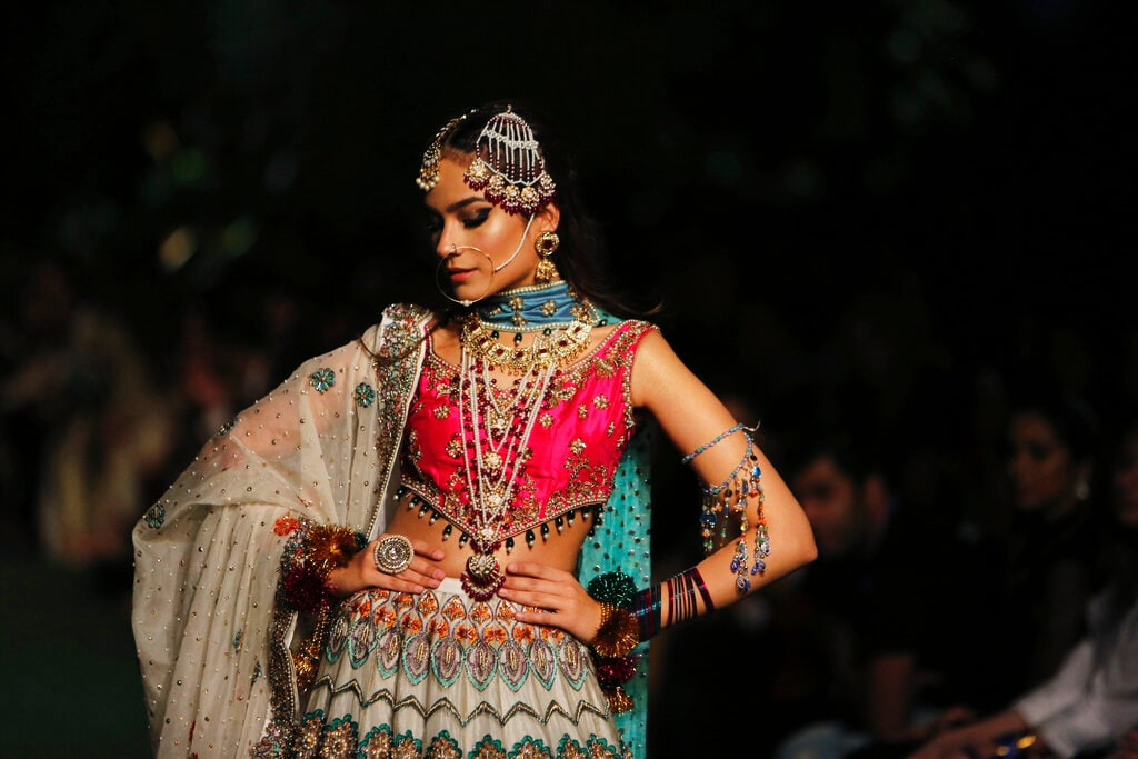 A model presents a creation by designer J&H Studio during the Bridal Fashion Week organised by the Pakistan Fashion Design Council in Lahore, Pakistan, Friday, Sept. 27, 2019. (AP Photo/K.M. Chaudary)