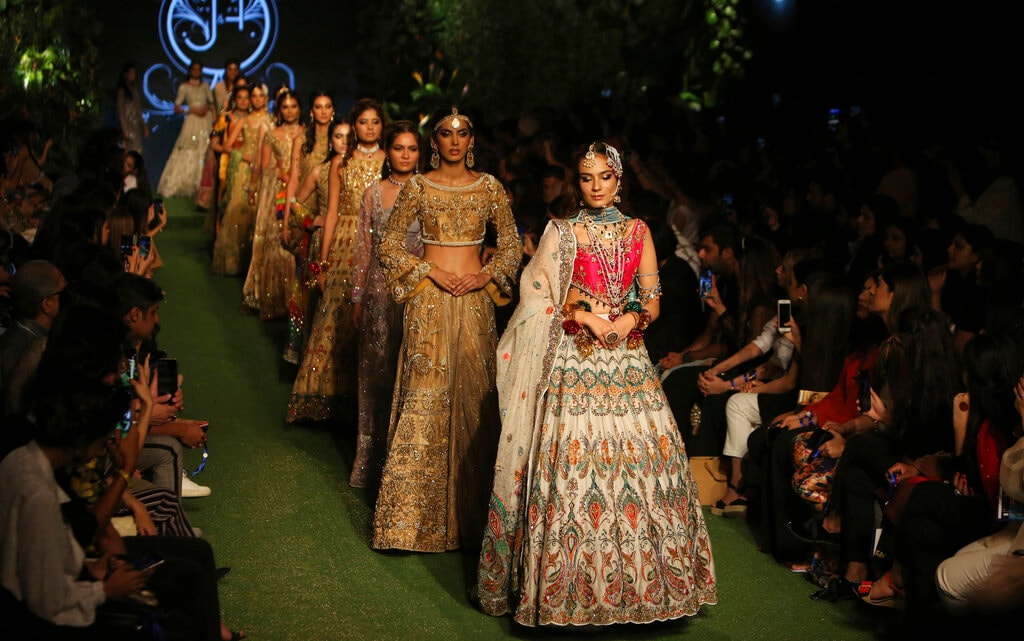 Models present creations by designer J&H Studio during the Bridal Fashion Week organised by the Pakistan Fashion Design Council in Lahore, Pakistan, Friday, Sept. 27, 2019. (AP Photo/K.M. Chaudary)