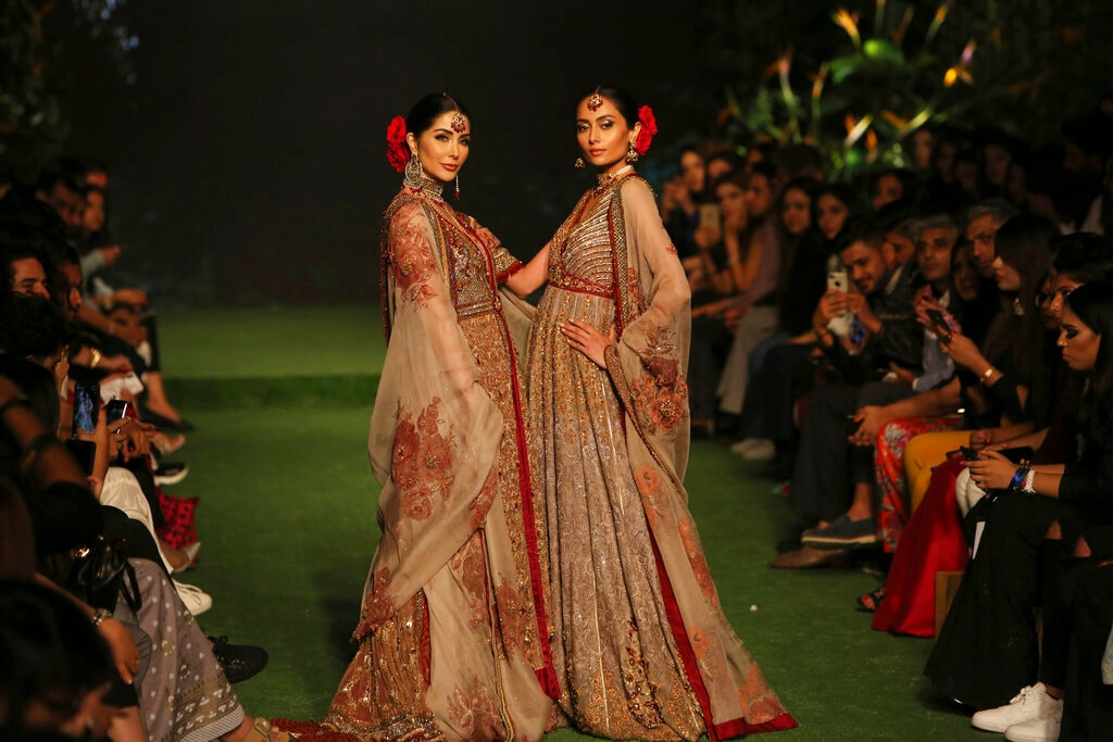 Models present creations by designer The House of Kamiar Rokni during the Bridal Fashion Week organised by the Pakistan Fashion Design Council in Lahore, Pakistan, Friday, Sept. 27, 2019. (AP Photo/K.M. Chaudary)