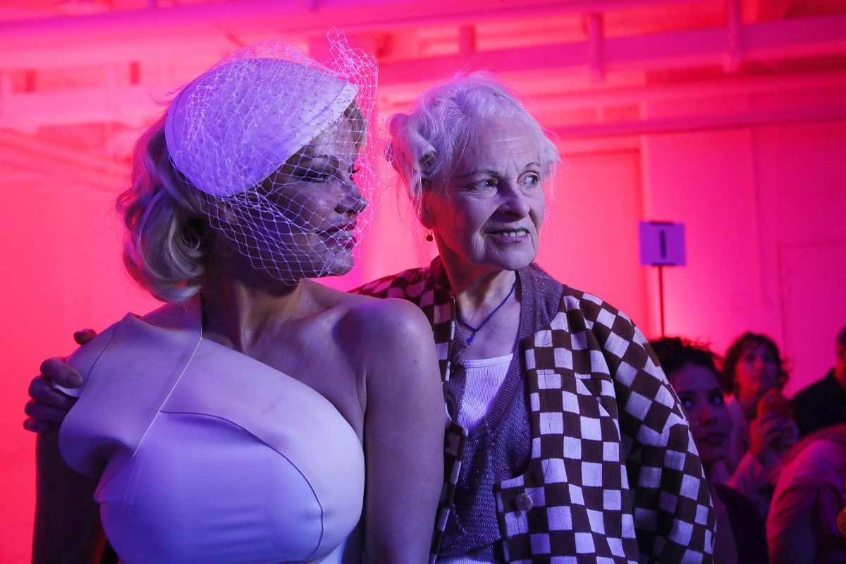 Actress Pamela Anderson, left, and designer Vivienne Westwood poses for photographers prior to the Vivienne Westwood Ready To Wear Spring-Summer 2020 collection. (Photo by Vianney Le Caer/Invision/AP)