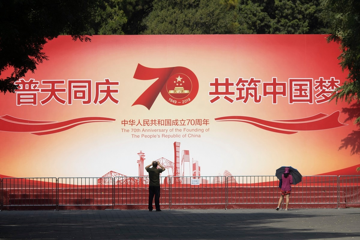 Patriotic banners, elaborate flower displays and tightened security are all on tap as the Chinese capital prepares to mark the 70th anniversary of Communist Party rule on Tuesday. (AP Photo/Ng Han Guan)