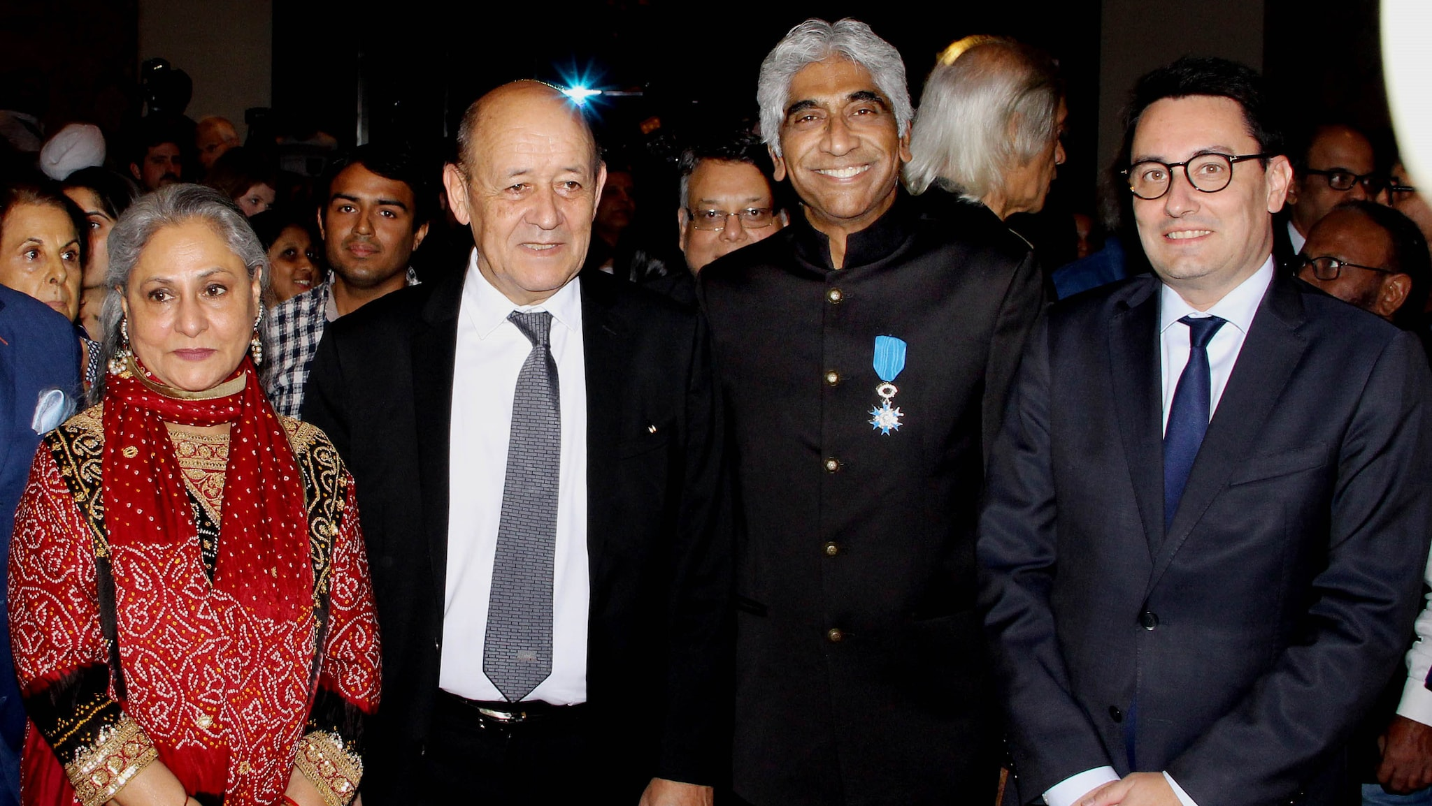 Amritraj receives the Chevalier de L'Ordre des Arts et des Lettres medal from France. (L to R) Jaya Bachchan, French Foreign Minister Jean-Yves Le Drian, Ashok Amritraj, and French Ambassador to India Alexandre Ziegler.