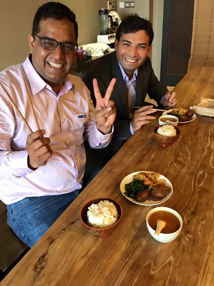 Sharma with a friend at a restaurant in Mumbai. Courtesy: Vijay Shekhar Sharma's Facebook page