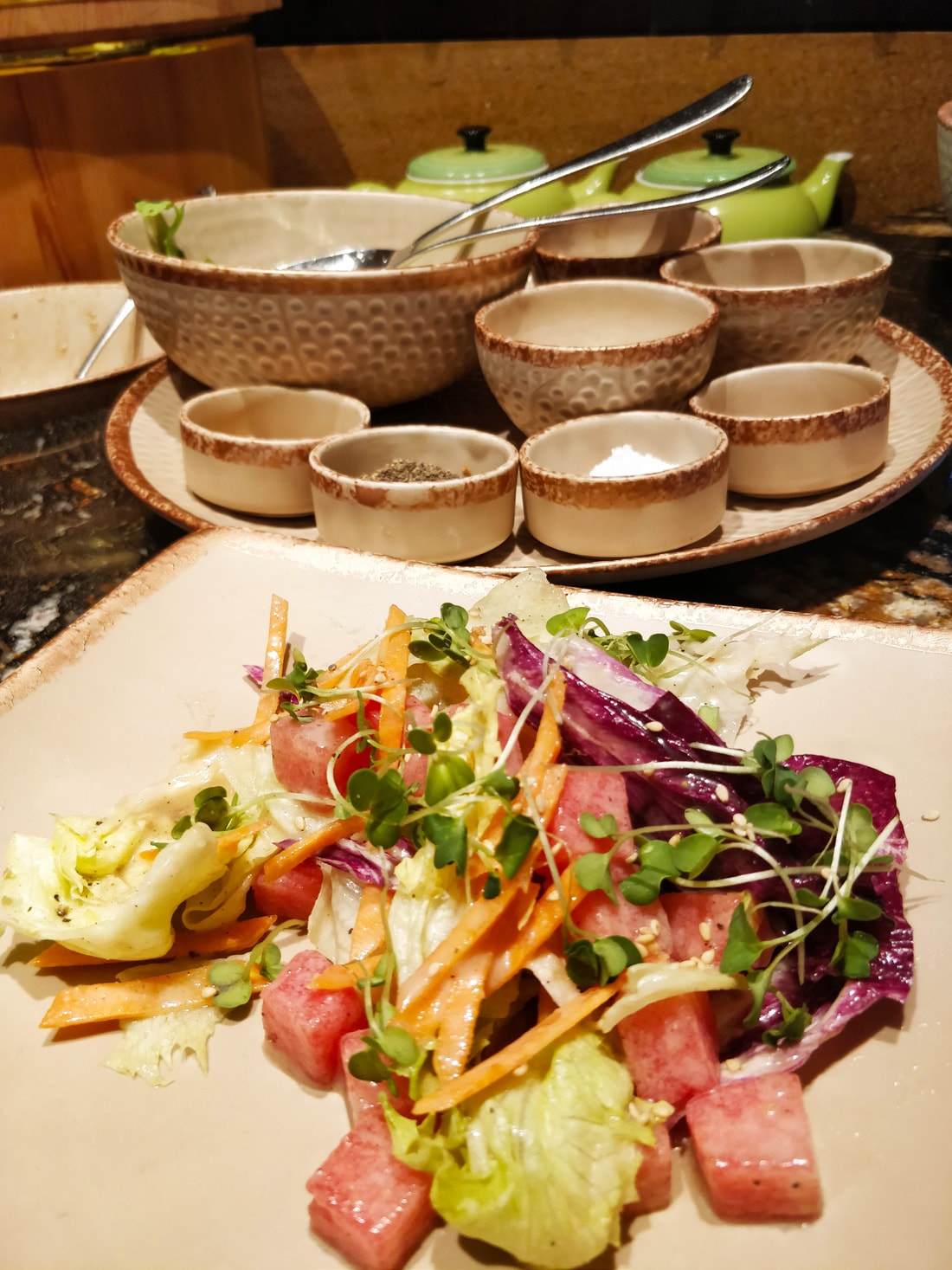 Fresh salad topped with sesame dressing