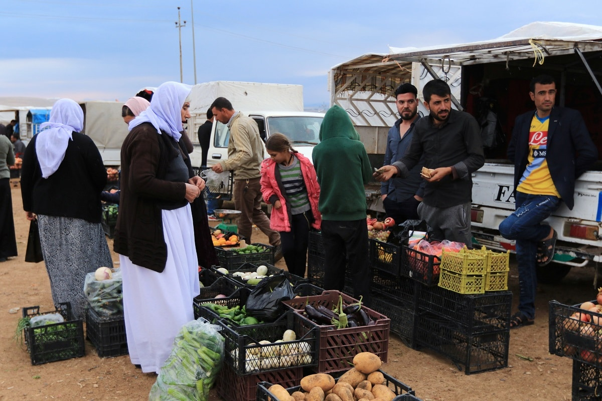 Displaced people from the Yazidi religious minority buy vegetables at the Sharya camp, in Duhok. Inspired by Abu Bakr al-Baghdadi's edicts to enslave and slaughter Yazidis, who IS regard as infidels, his followers shot, beheaded and kidnapped thousands in a rampage which the United Nations called a genocidal campaign against them. REUTERS/Ari Jalal.