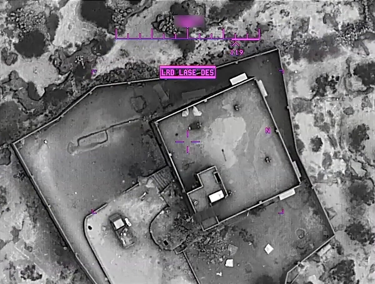 The compound of Islamic State leader Abu Bakr al-Baghdadi is seen moments before an airstrike in the Idlib region of Syria. The declassified, grainy, black-and-white aerial videos from Saturday's raid showed US special operations forces closing in on the compound and US aircraft firing on militants nearby. US Department of Defense/Handout via REUTERS.