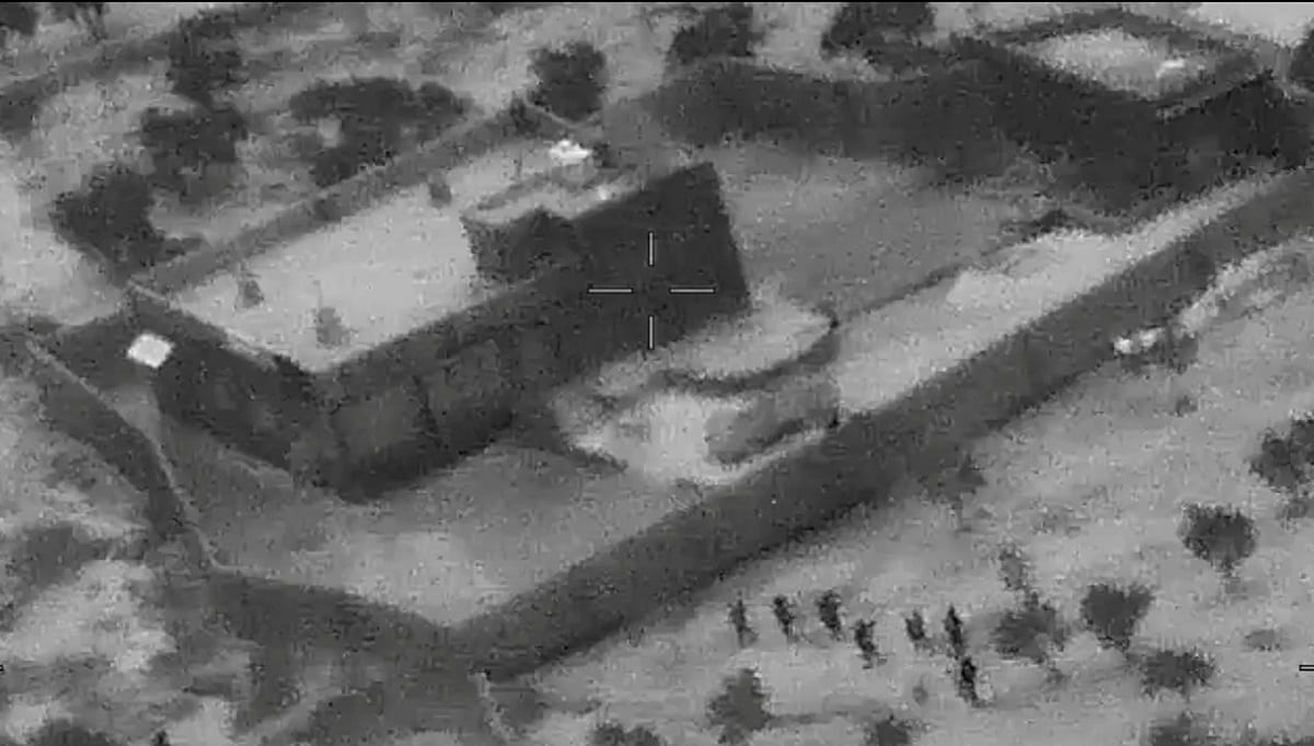 The US special forces move towards the compound of Islamic State leader Abu Bakr al-Baghdadi during a raid in the Idlib region of Syria. The US Department of Defense/Handout via REUTERS.