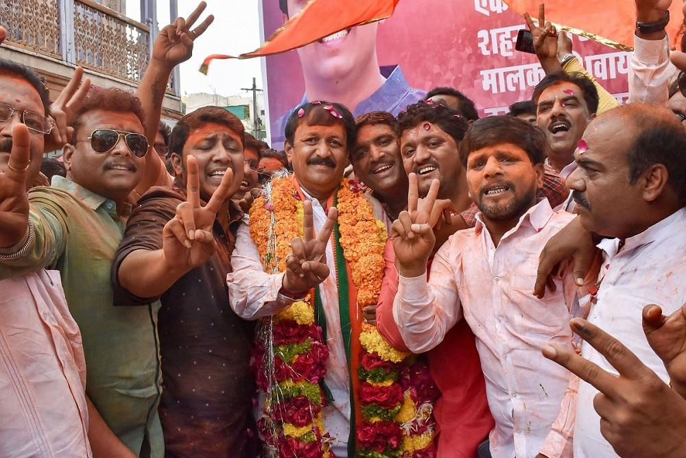 BJP candidate from Solapur seat Vijaykumar Deshmukh flashes the victory sign after he won the Assembly election, in Solapur. (PTI Photo)
