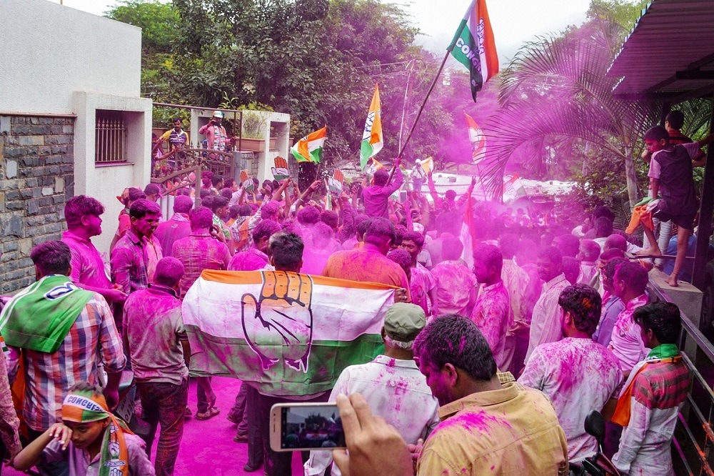 Congress supporters celebrate former chief minister Prithviraj Chavan's victory in Maharashtra Assembly election, in Karad. (PTI Photo)