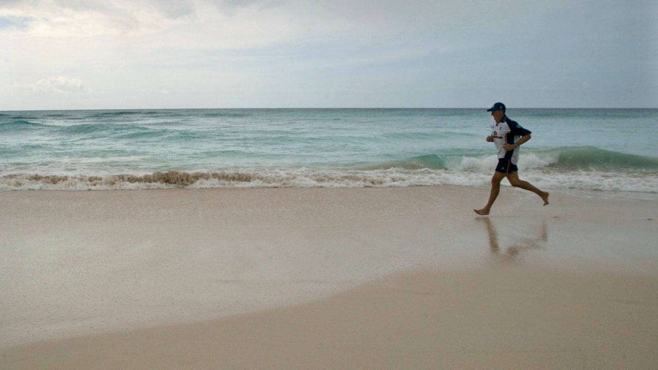 <strong>Barbados</strong> | Cost per litre - Rs 134.13 | A man is seen running on a beach in Barbados. (Image: Reuters)