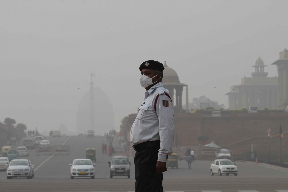A traffic police personnel wears a mask to protect himself from pollution in New Delhi. The air quality reached