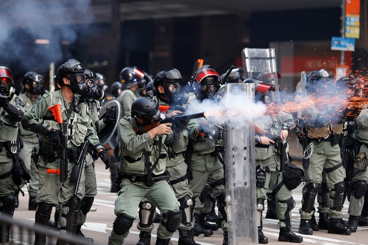 Police fire tear gas to disperse anti-government protesters in Hong Kong. Thousands of black-clad protesters marched in central Hong Kong as part of multiple pro-democracy rallies Tuesday urging China's Communist Party to