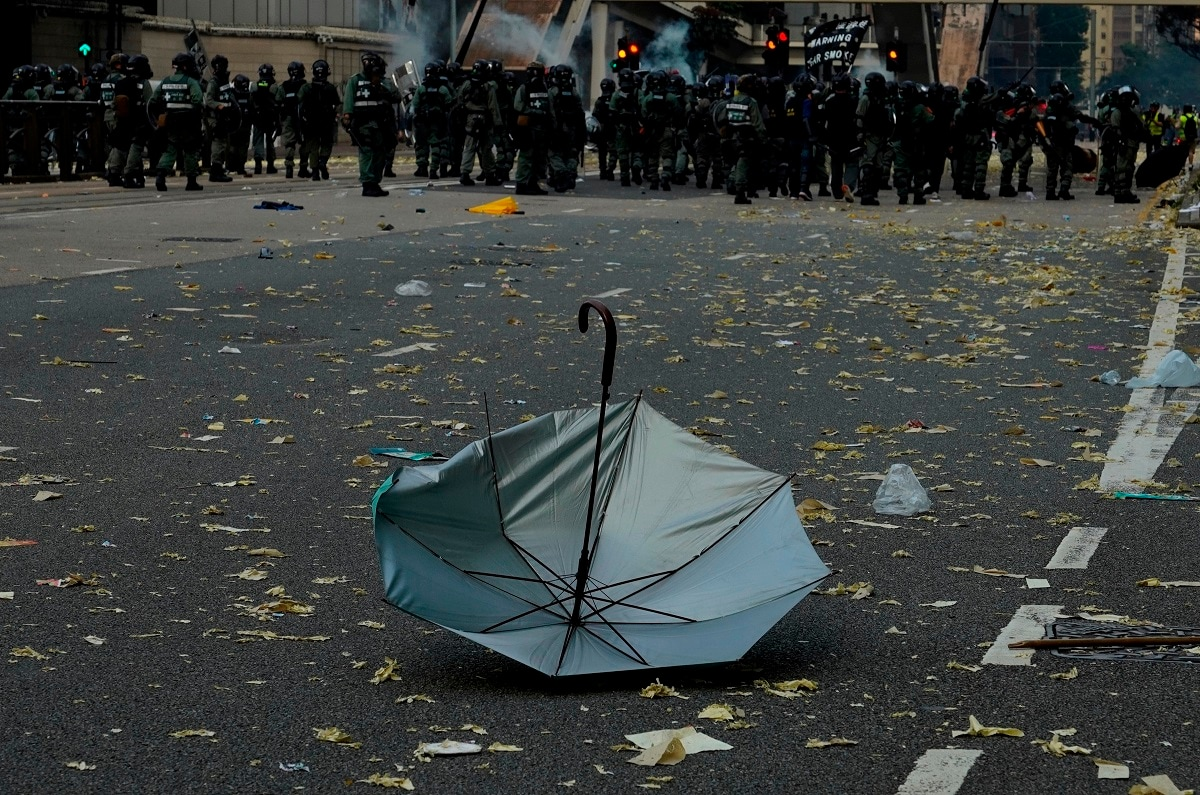An anti-government protester's umbrella lies on the ground after a clash with police in Hong Kong. (AP Photo/Vincent Yu)
