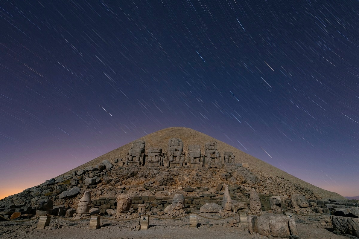 In this early time exposure photo, massive stone head statues are seen at the archaeological site of Mount Nemrut in Adiyaman. (AP Photo/Emrah Gurel)