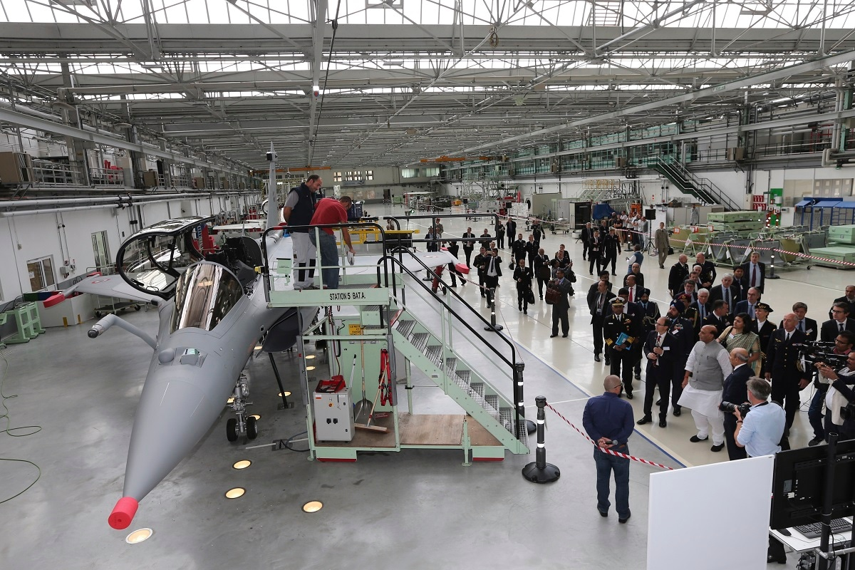 Defense Minister Rajnath Singh, third right, visits the Rafale jet fighter assembly line in Merignac, near Bordeaux, southwestern France. Rajnath Singh formally accepted the first Rafale fighter jet after India had signed a deal with the French government and Dassault Aviation in September 2016, to acquire 36 Rafale fighter jets. (AP Photo/Bob Edme)