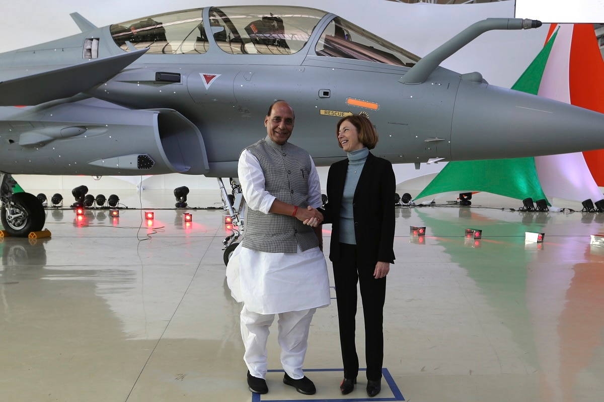 Minister Rajnath Singh shakes hands with French Defense Minister Florence Parly at the Dassault Aviation plant in Merignac. (AP Photo/Bob Edme)