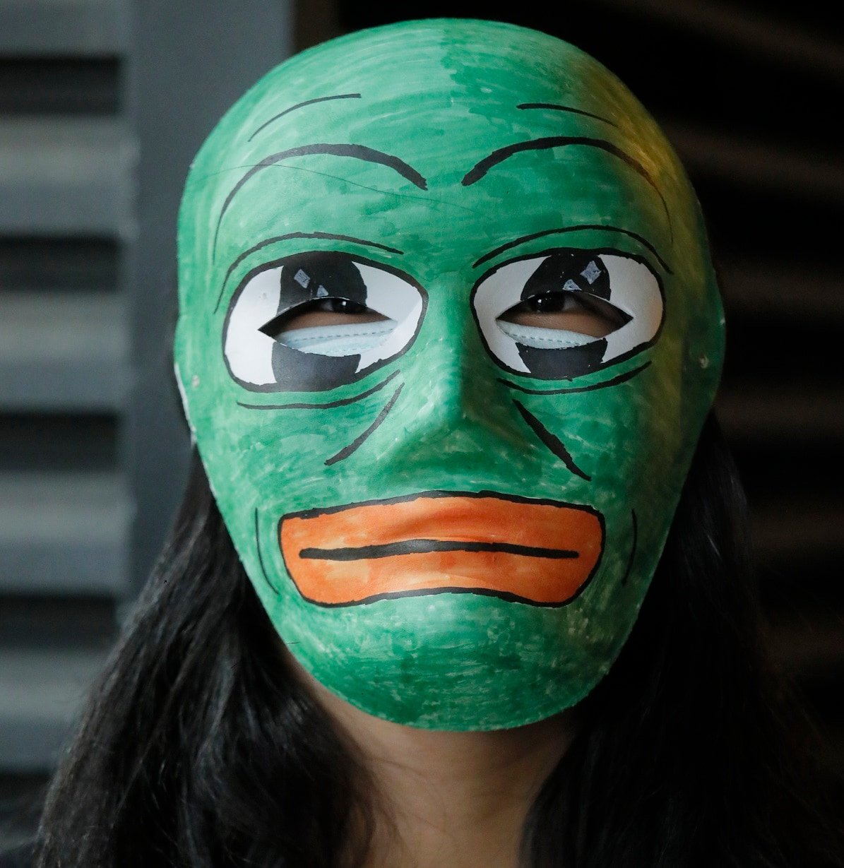 Some became Pepe the Frog, a character adopted by Hong Kong protesters unaware of its association with US far-right extremists. (AP Photo/Kin Cheung)