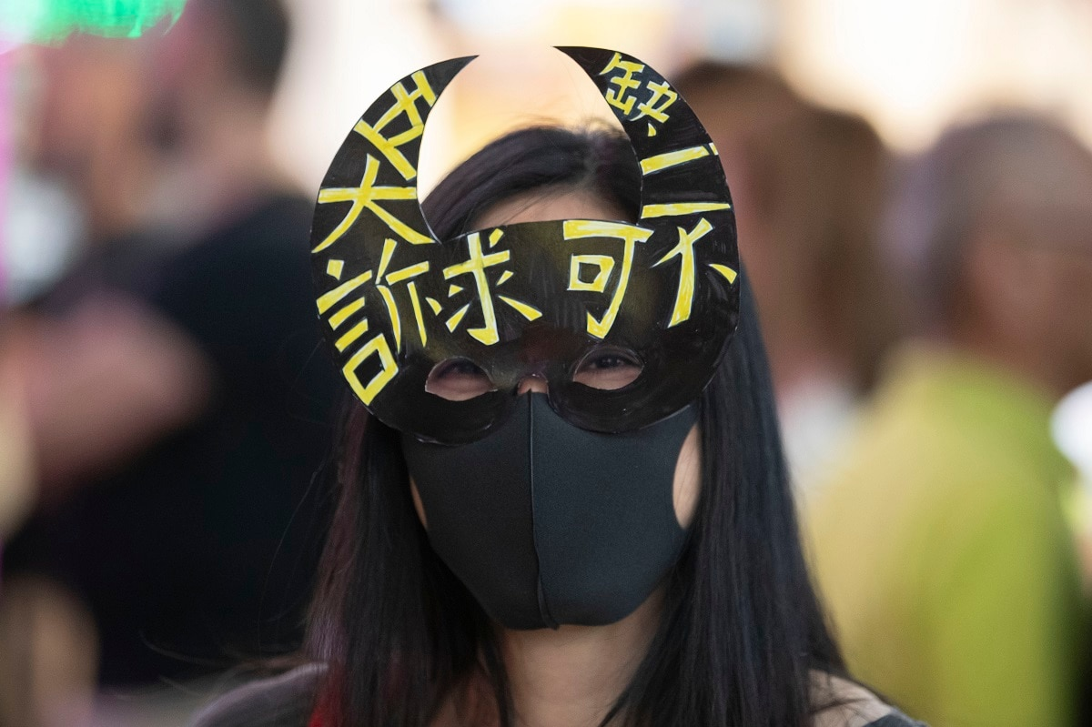 A protester wears a mask during a demonstration in Hong Kong. (AP Photo/Mark Schiefelbein)