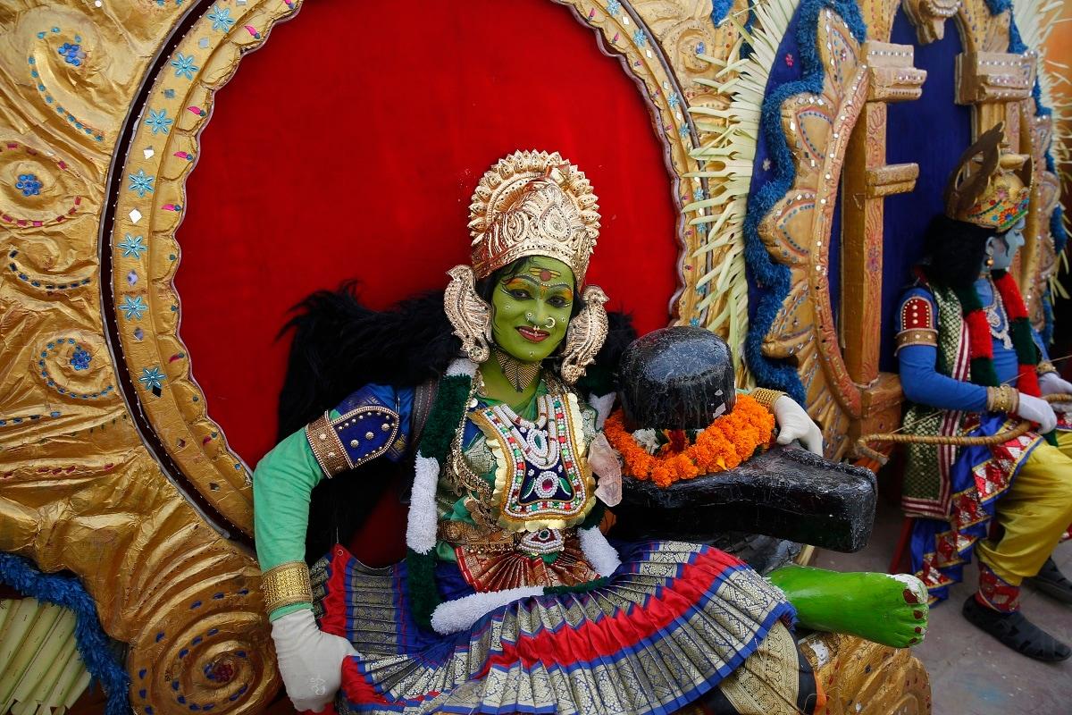 An artist sits dressed as a Hindu goddess during celebrations marking Diwali in Ayodhya. (AP Photo/Rajesh Kumar Singh)