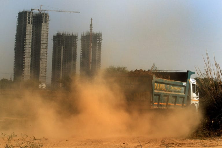 Dust and pollution rising from a construction site in Gurugram. Photo by Manoj Kumar.
