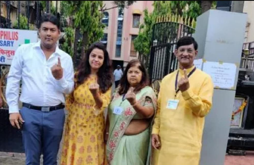 BJP candidate Vidya Thakur and her family show their ink marked fingers as they pose for a photo after casting their votes, in Mumbai. (Image: News18)