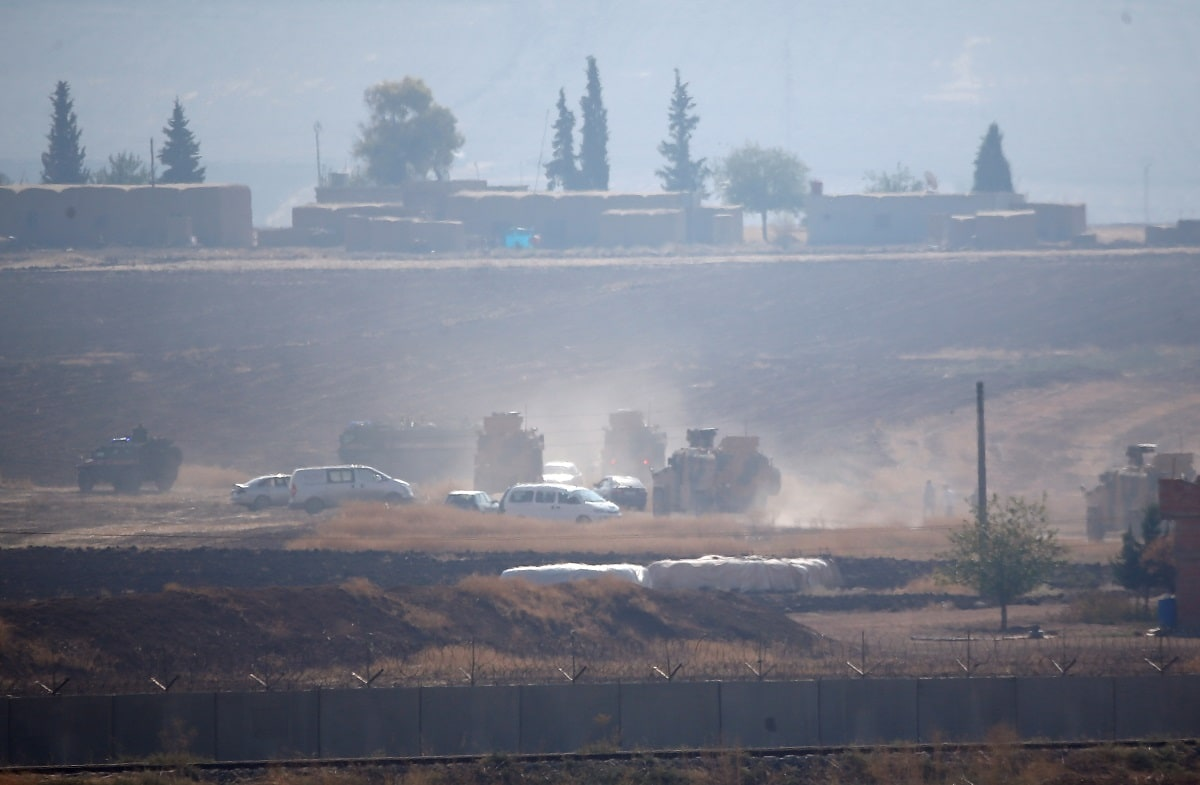 Turkish and Russian troops in armoured vehicles held their first joint ground patrols in northeast Syria on Friday under a deal between the two countries that forced a Kurdish militia away from territory near Turkey's border. REUTERS/Kemal Aslan