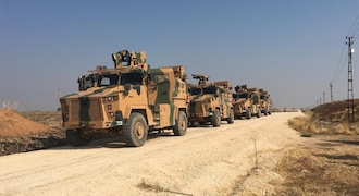 In Pictures: Turkey, Russia hold first joint patrol in northeast Syria