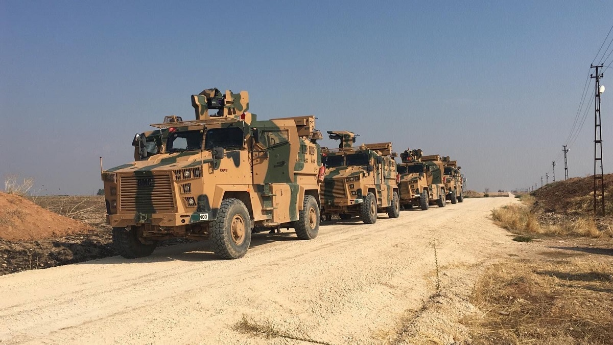 Ground and air units were involved in the patrol around the Syrian border town of Darbasiya, the Turkish Defence Ministry said on Twitter, showing photos of soldiers studying a map and of four armoured vehicles. Turkish Defence Ministry/Handout via REUTERS