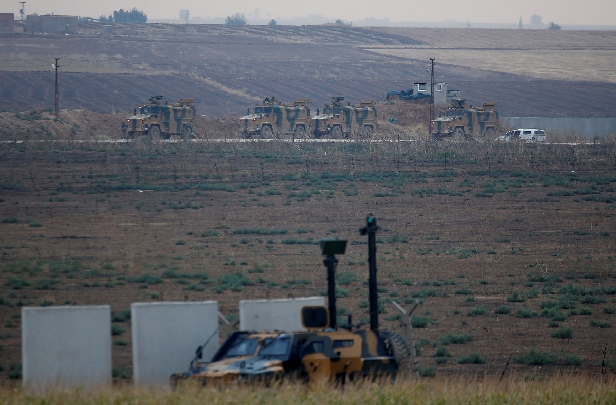 Turkish military vehicles return following a joint Turkish-Russian patrol in northeast Syria, as they are seen near the Turkish border town of Kiziltepe in Mardin province. REUTERS/Kemal Aslan