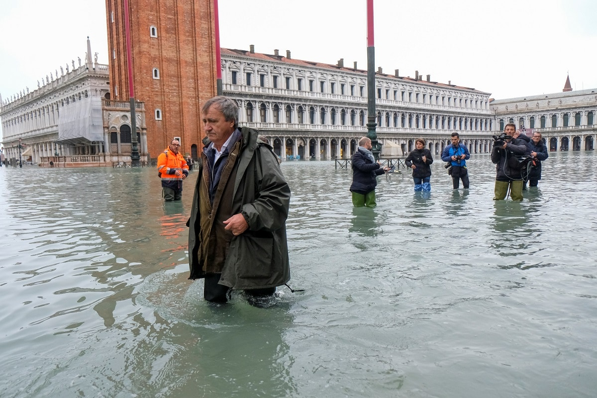 The Mayor of Venice Luigi Brugnaro walks on St Mark's Square during an exceptionally high water level in Venice. Saint Mark's Square was submerged by more than one metre of water, while the adjacent Saint Mark's Basilica was flooded for the sixth time in 1,200 years - but the fourth in the last 20.  REUTERS/Manuel Silvestri