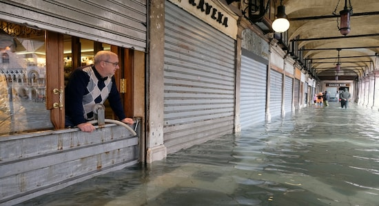 A man stands inside is store in St. Mark's Square after days of severe flooding in Venice, Italy, November 17, 2019. REUTERS/Manuel Silvestri