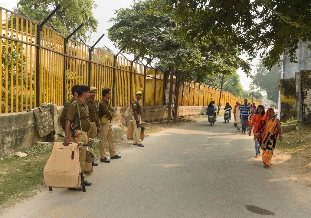 Police personnel leave after being discharged of their duty for the day from near the disputed Ram Janambhoomi-Babri Masjid site, as the verdict date nears, in Ayodhya, Friday, Nov. 8, 2019. (PTI Photo)