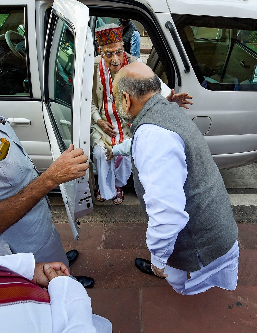 Union Home Minister Amit Shah seeks blessings from senior BJP leader Murli Manohar Joshi as the latter arrives on the first day of the Winter Session of Parliament. (PTI Photo/Atul Yadav)(PTI11_18_2019_000121B)