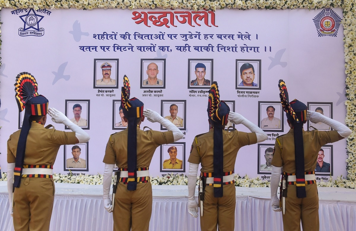 Police personnel pay homage at the Police Martyr's Memorial on the 11th anniversary of Mumbai terror attacks. (PTI Photo/Shashank Parade)