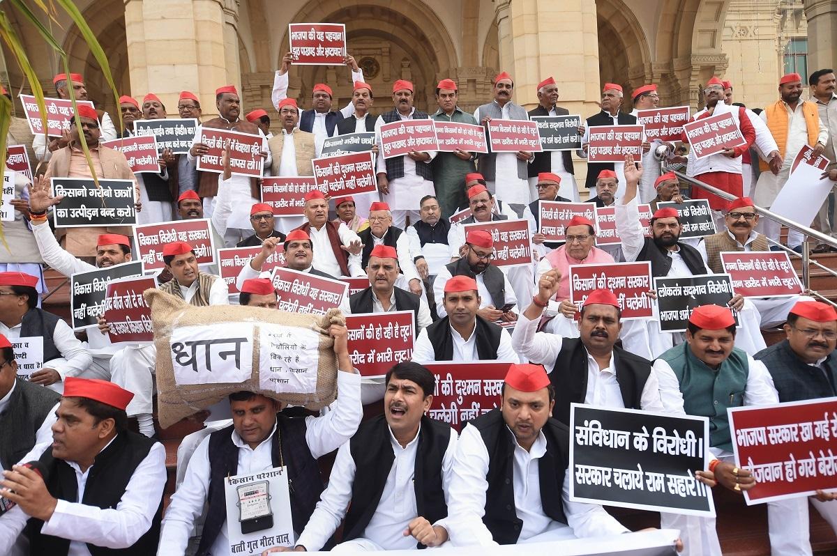Samajwadi Party legislators stage a 'Samvidhan Bachao' sit-in at Uttar Pradesh Assembly premises on the occasion of Samvidhan Diwas. (PTI Photo/Nand Kumar)