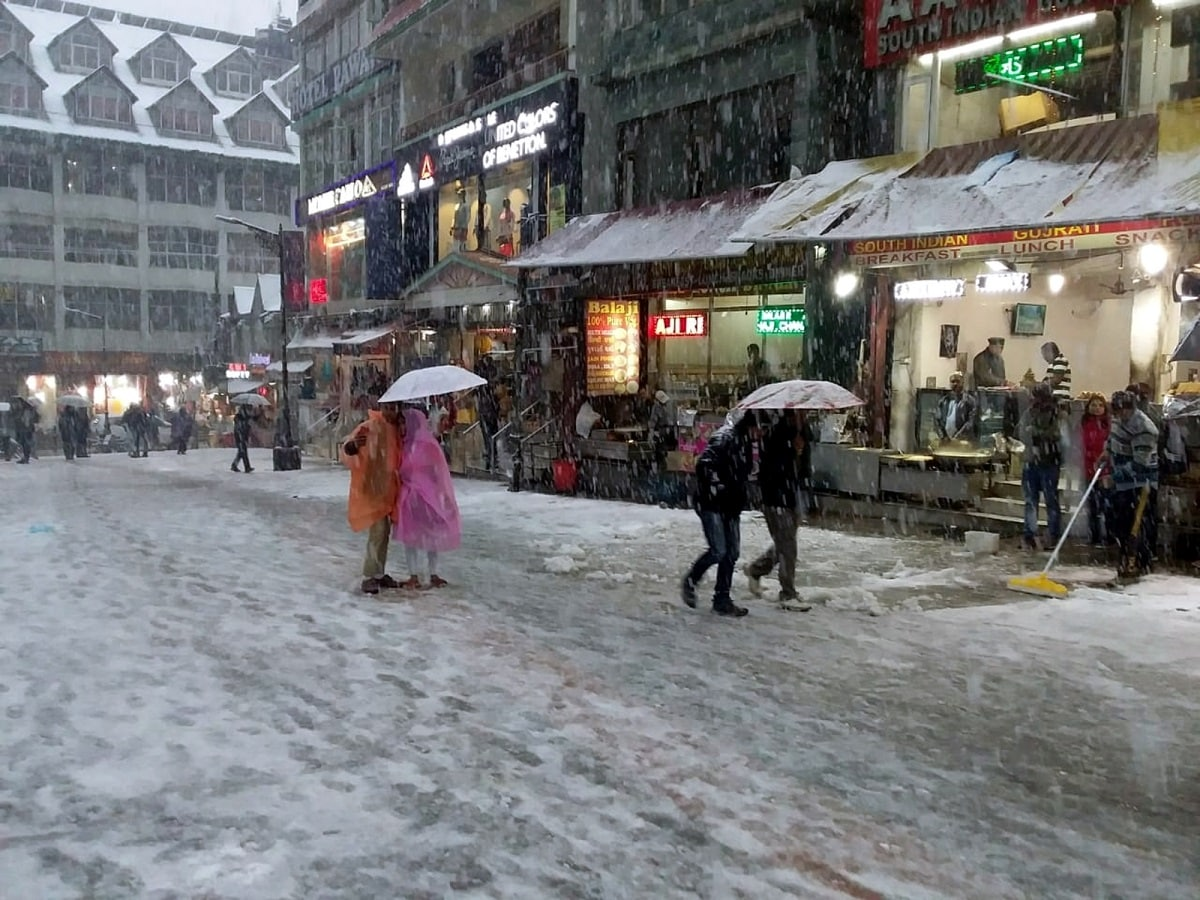 Picturesque tourist resort Kalpa in Himachal Pradesh was wrapped in a blanket of snow to the glee of tourists, the weather office said on Wednesday.  (Photo: IANS)