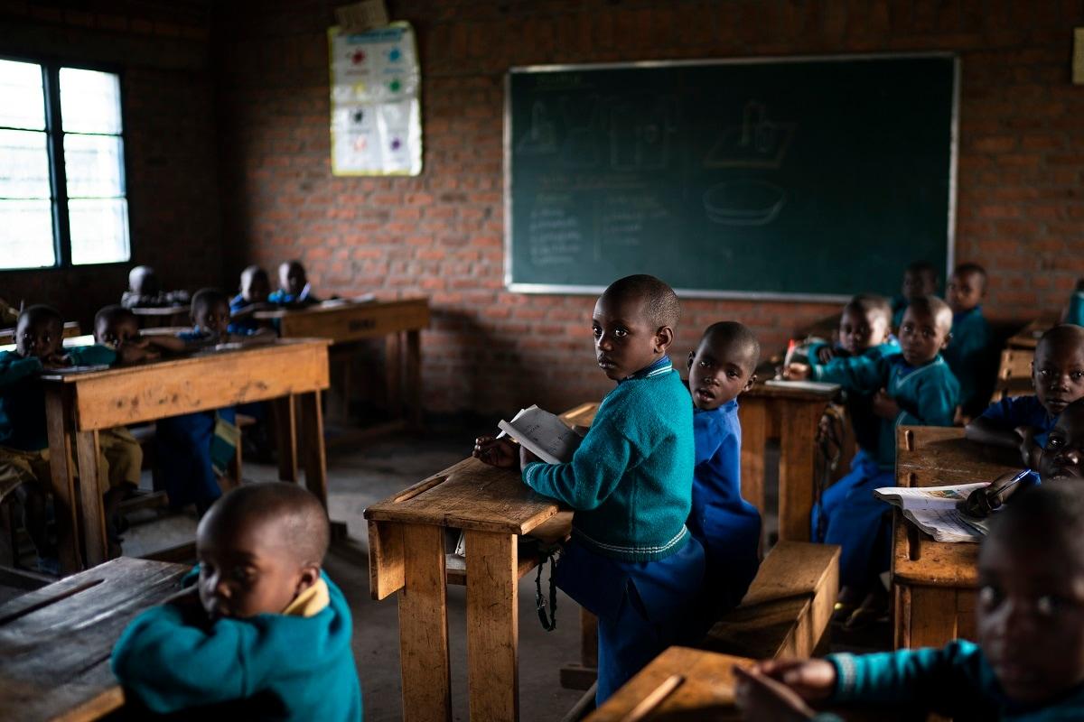 Children attend class at the Nyabitsinde Primary School near the Volcanoes National Park in Kinigi, Rwanda. (AP Photo/Felipe Dana)
