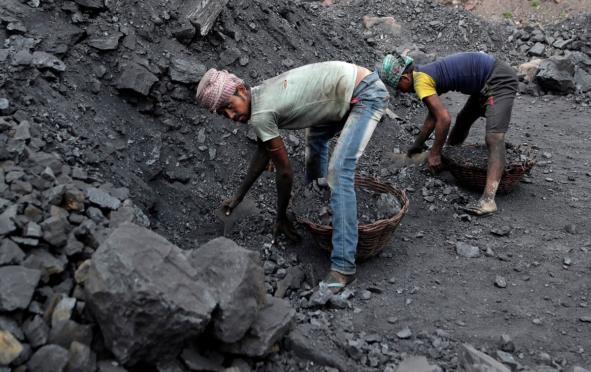 The fires started in coal pits in eastern India in 1916. More than a century later, they are still spewing flames and clouds of poisonous fumes into the air, forcing residents to brave sizzling temperatures, deadly sinkholes and toxic gases. (AP Photo/Aijaz Rahi)