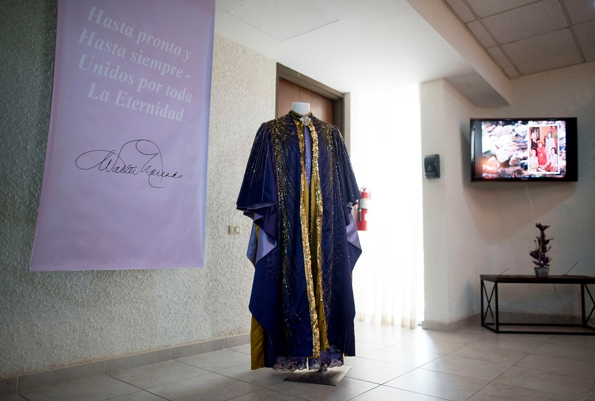 A cape worn by the late television astrologer Walter Mercado is on display during a public wake in the Santurce neighbourhood, San Juan, Puerto Rico. Mercado, whose glamorous persona made him a star in Latin media and a cherished icon for gay people in most of the Spanish-speaking world, died Saturday. He was 88. (AP Photo/Carlos Giusti)
