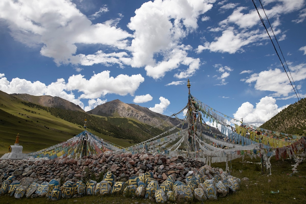 Tibetan prayer flags are seen during a clear day in Angsai, an area inside the Sanjiangyuan region. Qinghai is a vast region in western China abutting Tibet and shares much of its cultural legacy. (AP Photo/Ng Han Guan)