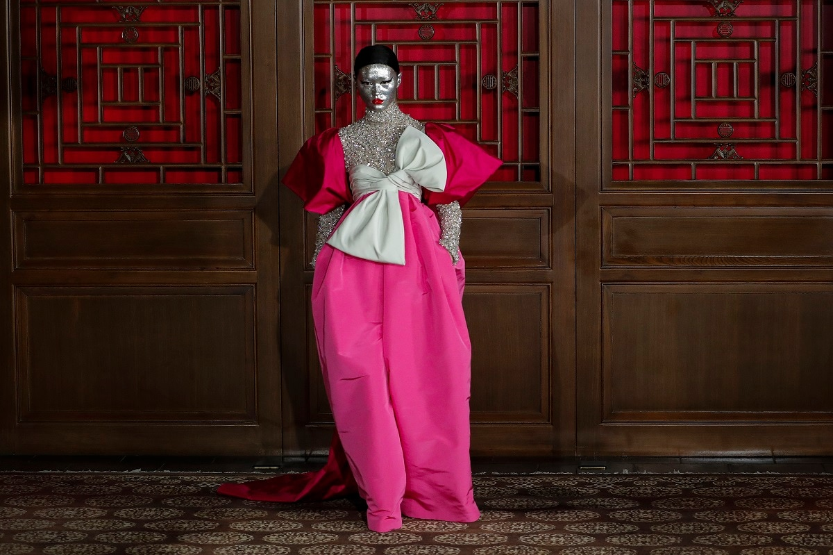 A model presents a creation from Valentino Haute Couture collection by designer Pierpaolo Piccioli during a fashion show at the Aman Summer Palace in Beijing. (AP Photo/Andy Wong, File)