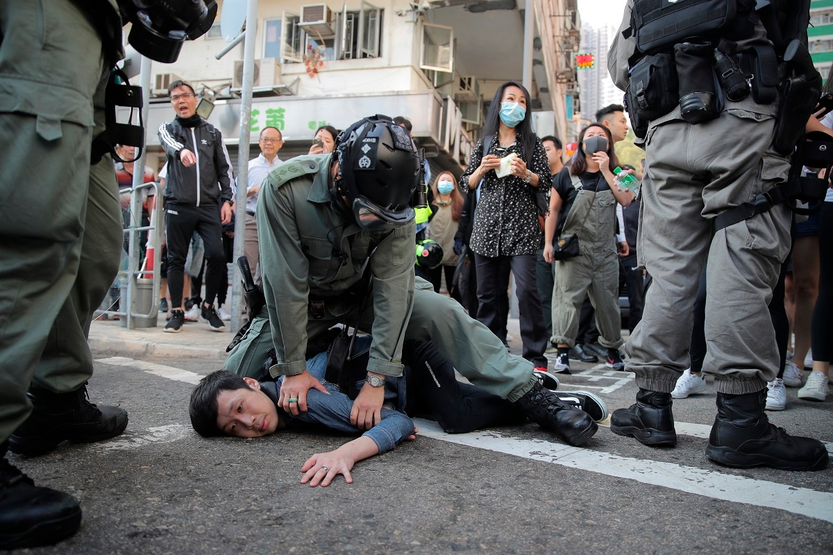 A protester is detained in Hong Kong. Hong Kong is in the sixth month of protests that began in June over a proposed extradition law and have expanded to include demands for greater democracy and other grievances. (AP Photo/Kin Cheung, File)
