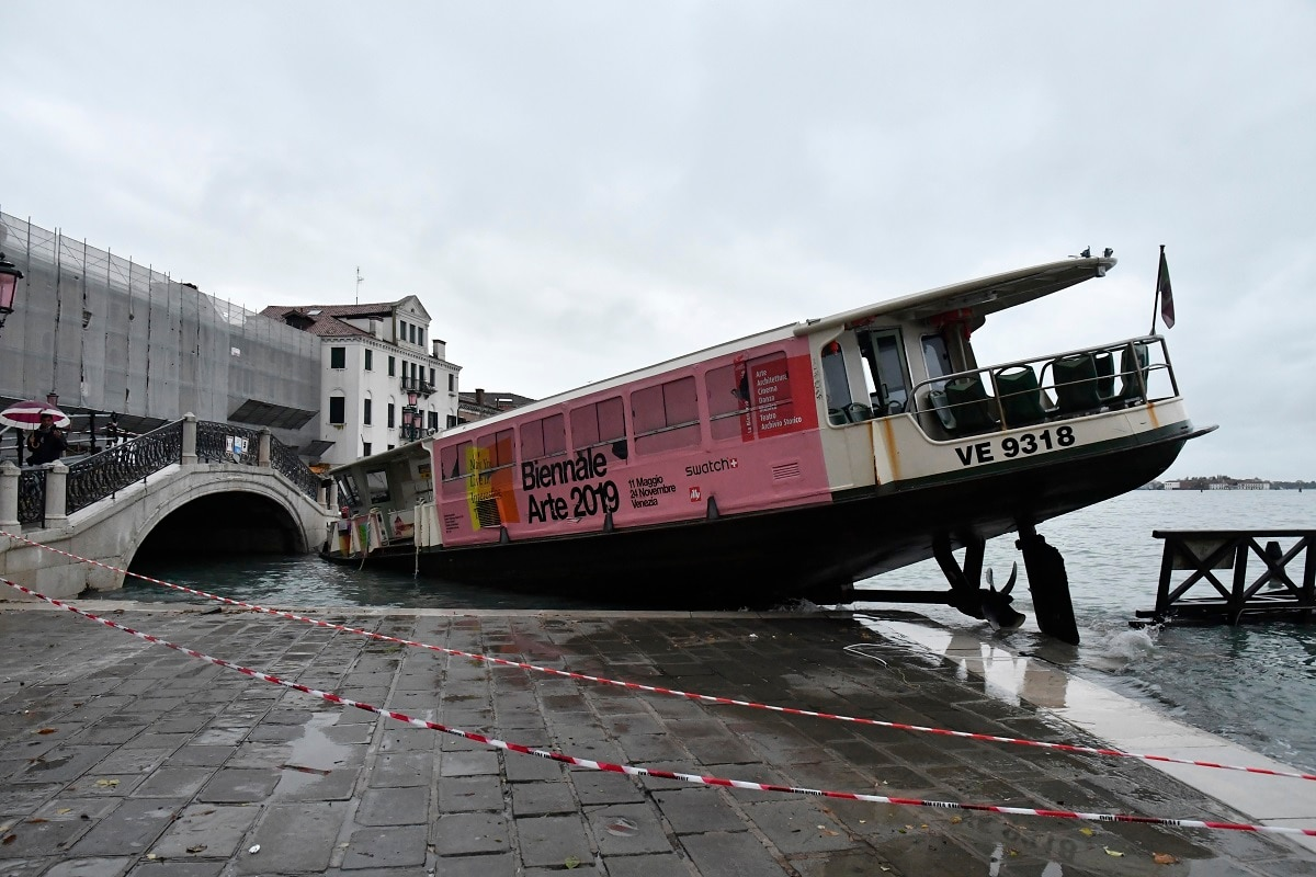 A stranded ferry boat lies on its side, in Venice. (AP Photo/Luigi Costantini)