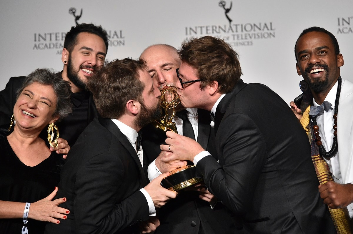Writer Fabio Porchat, second from right, poses with the 'Especial de Natal Porta dos Fundos' team in celebration of their best comedy award win. (Photo by Evan Agostini/Invision/AP)
