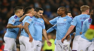 Manchester City players celebrate with Ilkay Gundogan, center, after he scored his side's first goal during the group C Champions League soccer match between Manchester City and Shakhtar Donetsk at the Etihad Stadium in Manchester, England, Tuesday, Nov. 26, 2019. (AP Photo/Dave Thompson)
