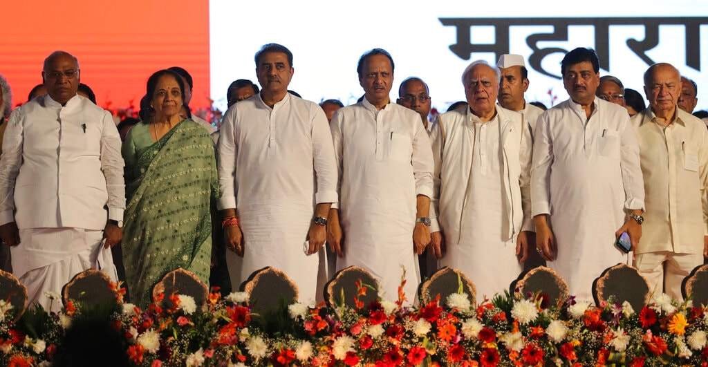 Leaders of various political parties stand for the national anthem during a swearing-in-ceremony of Shiv Sena party leader Uddhav Thackeray as chief minister of Maharashtra state during a swearing-in-ceremony in Mumbai, Thursday, Nov. 28, 2019. (AP Photo/Rafiq Maqbool)