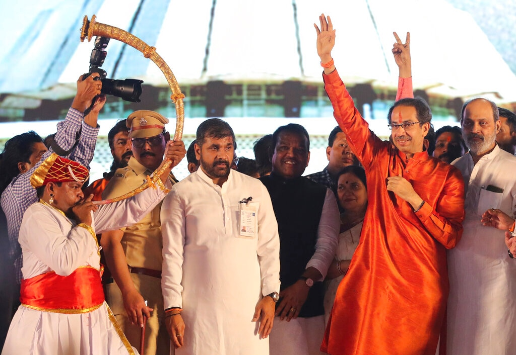 Shiv Sena party leader Uddhav Thackeray, second right, waves after after taking oath as the chief minister of Maharashtra state during a swearing-in-ceremony in Mumbai, Thursday, Nov. 28, 2019. (AP Photo/Rafiq Maqbool)