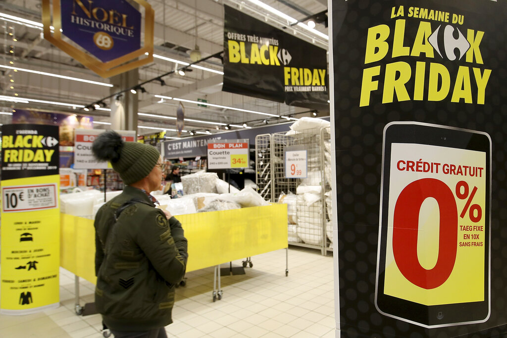A customer walks down the aisle of a shop in the Carrefour Shopping center at the eve of the Black Friday event, in Cesson, western France, Thursday, Nov. 28, 2019. Some French lawmakers are considering banning Black Friday, the post-Thanksgiving sales event that has morphed into a global phenomenon. (AP Photo/David Vincent)